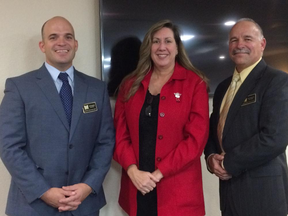 Picture of board members Donabedian, Van Dam, and Dettorre after being sworn in